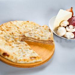 Осетинский пирог с мясом, грибами и сыром