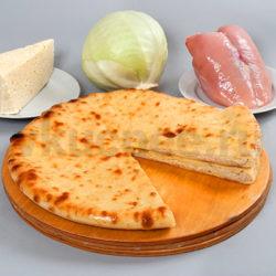 Осетинский пирог с сыром, курицей и капустой фото